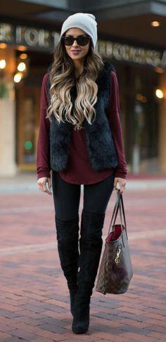 Maria Vizuete + winter's hottest new trends + faux fur vest + black piece + whole new dimension of glamour + Maria's casual everyday style + we love it!   Vest/Jeans: Topshop, Top: Banana Republic, Boots: Sam Edelman, Bag: Louis Vuitton.