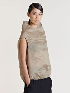 Avant garde Rick Owens beige raised collar cocoon top. Unique raised collar design that sits as the picture once it's on the body, very cleverly designed and cut. Cap sleeves design help create the signature futuristic cocoon shape Rick Owens has been know and recognised for.
