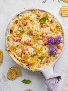 This hot lobster dip is bubbly and cheesy and topped with crunchy potato chips! Always a huge crowd pleaser and feels super fancy!