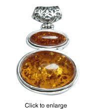 """Siluxe silver tone simulated double honey Amber pendant. Designed with 2 pieces of oval shaped simulated honey colored Amber stones. Pendant is 1"""" wide by 2"""" long. This item is fine silver plated.  Suggested Retail Price: $16.80  Blow Out Wholesale Price: $5.60"""