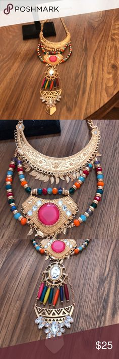 """Multi colored necklace brandnew never worn 17"""" in length 3"""" extender with gold small leaves hang from each layer multi color beads it's a beautiful piece Jewelry Necklaces"""