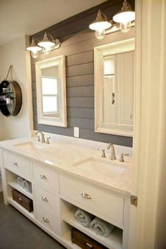 painted shiplap behind vanity, and like the lights.