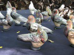 Beautiful raku-fired pigeons by Glo Coalson.