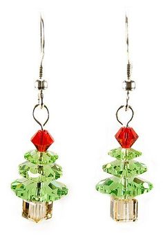 23184  Swarovski Peridot Christmas Tree Earrings Kit  These may be the only trees that you don't need to put lights onto!  This Christmas tree earring kit is made of Peridot Swarovski Marguerite beads, bicones and cubes.  The finishing touch is gleaming sterling silver findings.  Whip up a pair for a holiday party and give some out as gifts.  Comes complete with easy to follow directions.