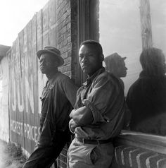 """""""In Memphis, Tennessee hundreds of colored laborers... are hauled to and from work on trucks. 'The people here in the morning are hungry, raggedy, but they don't make no hungry march' """" – June 1938, Dorothea Lange."""