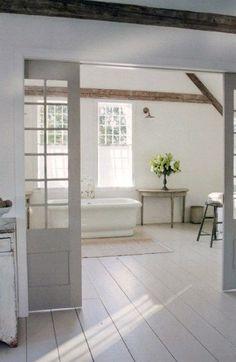 Rustic farmhouse bathroom with wide plank floors
