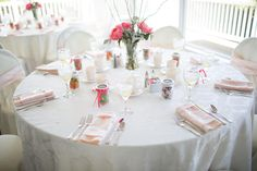 A simple table set up for a coral and navy summer themed wedding. Photo by @misspowers