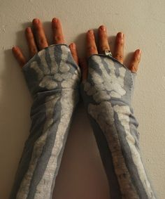 Batiked skeleton armwarmers.