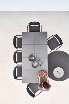 Less chairs, lava grey weaving and Pure dining table with tiles