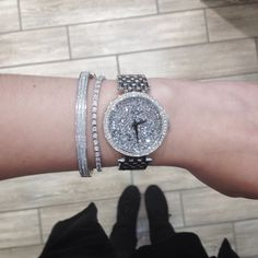 Super sparkly arm stack! Featuring a Caravelle by Bulova watch, diamond tennis bracelet, and white gold bangle.