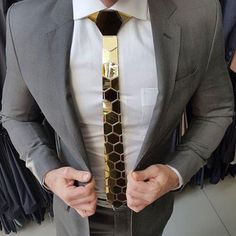 Plush Gold Mirror/Gloss Tie - Hex Honeycomb Style ( Suit Accessories - NeckTie )  ONE SIMPLE WORD... BE UNIQUE ! BE CLASSY !   Stand apart from the crowd by carrying this fashionable high quality tie on your night outs, parties, events or just another hangout.   These Ties are made of 84 rigid reflective lightweight gold color polymers embodying the shape of recurring hexagons. Assembled by hand, each tie reflects a custom setting,