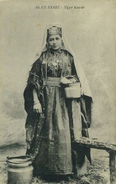 Kurdish lady in festive outfit.  From northern-Syria.  Late-Ottoman era, ca. 1900.
