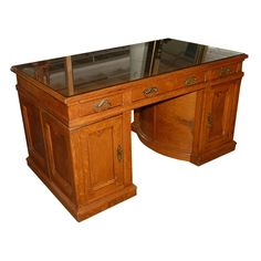 Elegant antique American Victorian Lawyers Own Wooton rotary desk circa 1885. This rare and beautiful desk is executed in oak and features a gold tooled brown leather top.