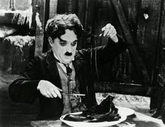 The Gold Rush .He is so poor & hungry he boils his shoes, in this scene his eating the shoelaces as if it were spaghetti.
