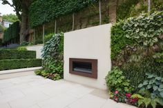 Trellis and Espalier Hedge Outdoor Stone Fireplaces, Modern Fireplace, Terrace Garden Design, Garden Works, London Garden, Diy Patio, Back Gardens, Lush Green, Tree Wall