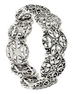 Questo meraviglioso braccialetto combina due tendenze della moda: lo stile etnico e moderni cut-out. Le piastrine rotonde in metallo color argento anticato sono decorate con dolci pietre di strass e sono separate l'una dall'altra...