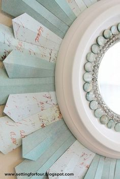 """Use beads, a ceiling medallion and scrapbook paper """"rays"""" to decorate a sunburst mirror."""