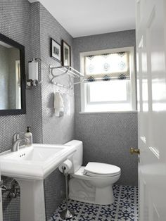 A small simple bathroom with special touches...love the tile walls and the moroccan floor tiles!