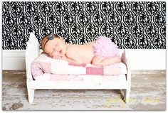 Looks like a babydoll bed, so cute for a picture prop!