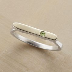 OPPORTUNITY RING�--�Atop our sterling silver ring, a peridot implanted in a field of 14kt gold represents growth. A handcrafted exclusive in whole sizes 5 to 9.