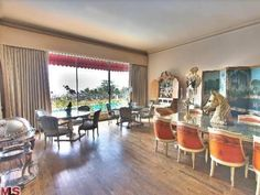 Zsa Zsa Gabor's LA Home: Formal Dining Room (think there are enough CHAIRS ?!?!?!  lol )