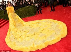 Rihanna's canary yellow gown made headlines following her appearance at the Met Gala on Monday - so who is the lady behind the extravagant design?