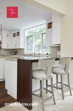 A beautiful wood waterfall countertop from Grothouse pops in this light, white kitchen and is a nod to the home's wooded surroundings. Waterfall Countertop, Wood Countertops, Transitional Kitchen, Kitchen Remodel, Kitchen Design, Luxury, Table, Room, Furniture