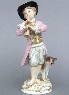 Meissen Model: 22        Description: Boy With Flute And Dog   Modeled By: Johann Joachim Kaendler ca. 1740   Mark: 22       Painter Number: 33 - Emil Ens    Height: 5.5 in - 14 cm