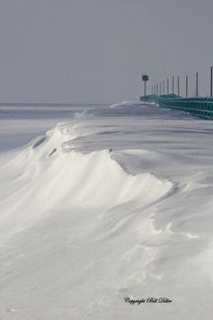 Snow drifted alongside the Caseville, Michigan breakwall.