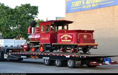 "This'll get a few second looks from drivers on Harbor Boulevard! Disneyland Railroad 2-4-0 #4, the ""Ernest S. Marsh,"" sits on a Dunkel Brothers (equipment movers) trailer in preparation for its journey a few miles south to home rails encircling the Disneyland theme park in Anaheim, California. Disneyland brought this narrow gauge engine to Fullerton for the annual Fullerton Railroad Days, and #4's diminutive size was contrasted nicely with the other display locomotives: Santa Fe 4-8-4 3751…"
