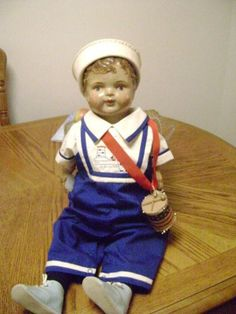 Antique Boy doll in red, white & blue.  Just as cute as can be.....