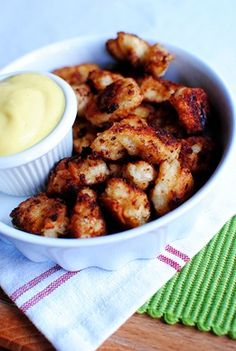 Chick-fil-A Bites with Honey Mustard (serves 2)  2 large chicken breasts, cut into bite-sized pieces and seasoned with salt & pepper  3/4 cup milk  1/4 cup pickle juice  1 egg  1 1/4 cups flour  2 Tablespoons powdered sugar  2 teaspoons salt  1 teaspoon pepper  1/2 cup peanut oil, divided (or canola or vegetable oil)