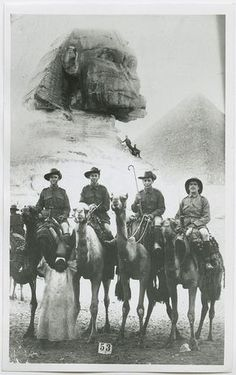 Sergeant C.B. Lewis, Private G.W. Hart, Private Howard N. Kimber, Sergeant F.C. McArtney on leave in Egypt, with the Sphinx and one of the pyramids behind them.