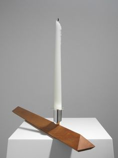 Designfenzider Candlestick No. 4 Candle Holder Candlestick No. 4 is a mirror-polished silver candleholder in cherry wood base design by Ron Gilad for Designfenzider. This candle holder attaches magnet