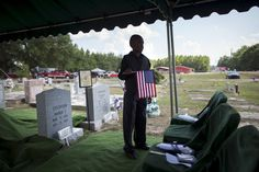 Week of June 20-26, 2015 Family friend Kendrell Heriot, 11, of Gresham, S.C., holds an American flag before the start of the burial service of Rev. Clementa Pinckney at the St. James AME Church cemetery in Marion, S.C. on Friday. RANDALL HILL/REUTERS