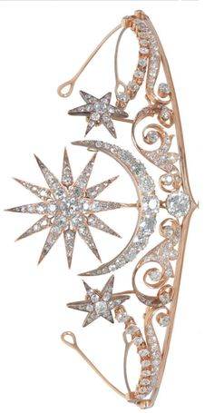 A diamond tiara/brooch/ring combination, circa 1900, Central sunburst and crescent moon motifs above a large cushion-shaped diamond, on a scrolling frame of shooting stars, set throughout with old brilliant-cut diamonds, mounted in gold. Brooch, hair ornaments, ring and tiara fittings and screw supplied, fitted case by Cav. Vincenzo Giura Giojelliere, Napoli. Image Bonhams, via http://www.bonhams.com/auctions.