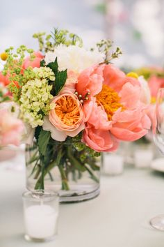 Pretty wedding centerpieces: http://www.stylemepretty.com/massachusetts-weddings/marion-massachusetts/2014/05/09/marion-summer-waterfront-wedding/ | Photography: Joyelle West - http://www.jwestwedding.com/