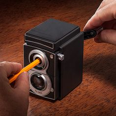 """This """"twin-lens reflex"""" pencil sharpener would look awesome on my new desk. $13.99 via @thinkgeek."""