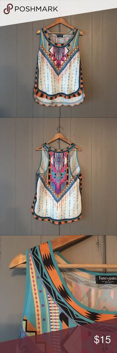 """Aztec Tribal print Tank Beautiful Boho racer back tank in like new condition. Pretty and bold pink, turquoise, purple and orange colors. You can't go wrong with this unique top! It would also be super cute layered. True to size. 100% Polyester. Armpit to armpit is 21"""". Length is 27"""". Fancyqube Tops Tank Tops"""