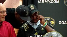 Charlotte Catholic running-back/linebacker Elijah Hood got a little emotional today after receiving his Army All-American jerse