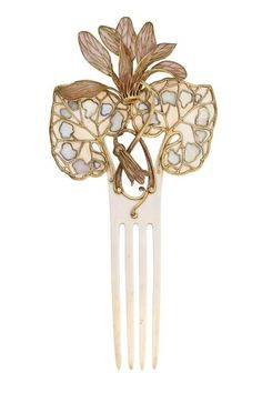 Lalique, c. 1902. Ivory, gold, and plique-a-jour enamel. An insect crawls to the plumes of a flower.
