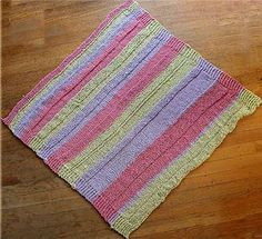 Striped blanket in three colors. The blanket is knit in St st and Reverse St st with garter stitch borders. Three skeins of color A and 2 skeins each of two other colors will make a slightly larger blanket, as shown in the featured project. Equal amounts of Color A & B (3 skeins each) will make a two toned striped blanket.