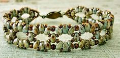 "Linda's Crafty Inspirations: Bracelet of the Day: London's Garden Bracelet--LONDON'S GARDEN BRACELET seed beads Miyuki ""Dark Bronze"" seed beads Miyuki ""Hybrid Opaque Brown Picasso"" SuperDuo beads ""Patina"" (smooth, not tapered Free Pattern link Boot Jewelry, Seed Bead Jewelry, Beaded Jewelry, Beaded Bracelets, Seed Beads, Beading Patterns Free, Jewelry Patterns, Free Pattern, Beading Ideas"