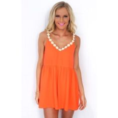 Orange romper Orange romper with flower detailing. Only worn once. It's a size 8 in Australian sizing so it's about a size 4!! Not sabo skirt but another store very similar! Sabo Skirt Dresses
