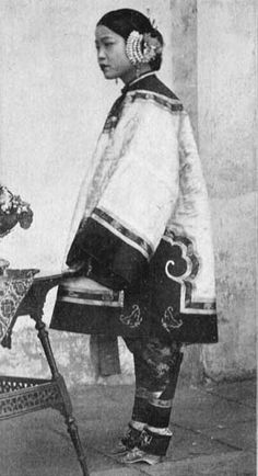 A large proportion of Chinese women in the late nineteenth century had their feet bound small while they were children.  The woman seen in this late nineteenth century photograph was an entertainer, a sing-song girl, but footbinding was also practiced by the families of scholars and merchants.