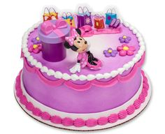 This Minnie Mouse cake topper will look adorable on top of a girl's birthday cake, and she'll love playing with the Minnie figurine and hat box that actually opens.