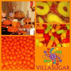 Mesa de caramelos naranja