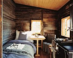 Chic Small Cabin - bed, kitchen & table shown in one room.  #micro_homes, #small_homes http://somethingbeautifuljournal.blogspot.com/2009/02/new-trophy-home-small-ecological.html?q=small+space