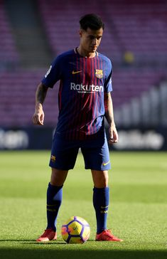 New Barcelona signing Philippe Coutinho kicks a ball on the pitch as he is unveiled at Camp Nou on January 8, 2018 in Barcelona, Spain. The Brazilian player signed from Liverpool, has agreed a deal with the Catalan club until 2023 season.