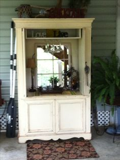 repurpose an old tv armoire into a beautiful outdoor piece perfect for a mini bar